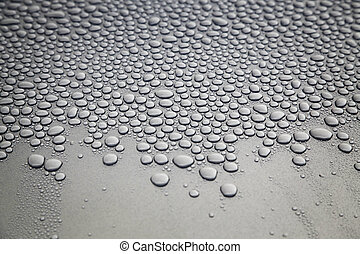 Water droplets - On gray background, water droplets covering...