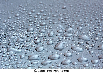 Water droplets on mettallic surface - Water droplets on a...