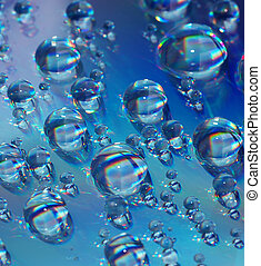 Water Droplets - Abstract - Closeup of Water Droplets on CD
