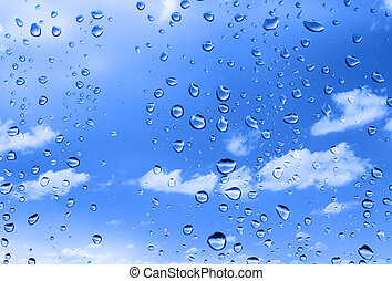 water drops against summer sky - water drops against bright ...