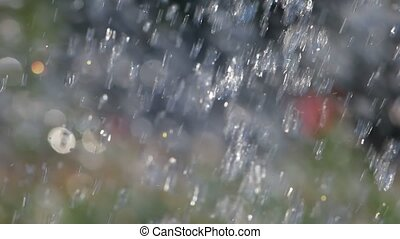 Water drops fly in the air. Great For Background.