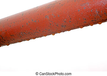 water drops in red steel pipe