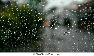 Water drops of rain on car windshield - Water drops steam of...