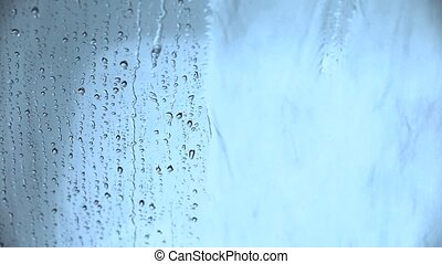 Water drops on a glass background.