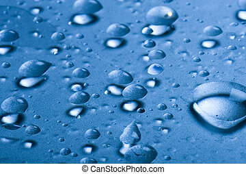Water drops on a glass surface