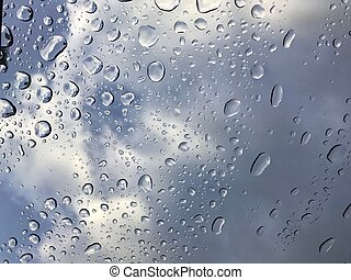 water drops on car window shield after rain stops