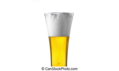 Water drops on glass of beer. Close up beer background