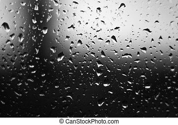 Water drops on glass. The window In rainy weather. Closeup