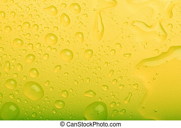water drops on yellow background