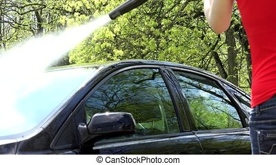 water drops splash from automobile car washed with high pressure tool.