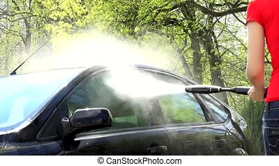 water drops splashing from automobile car washed with high pressure tool.