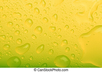 water drops yellow background