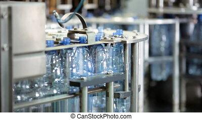 Water factory - Bottling machine in water factory