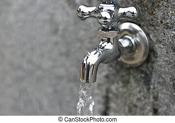 Water Faucets in a park with dripping water