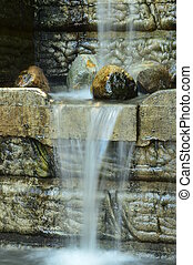 A small water feature flowing.
