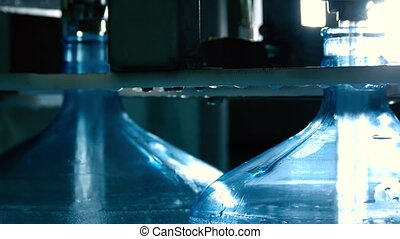 Water filling up bottles. Transparent liquid in motion. Best...