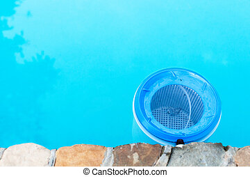 water filter at the wall of outdoor swimming pool