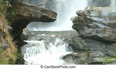 Water finding its way through the rocks - A steady, medium...