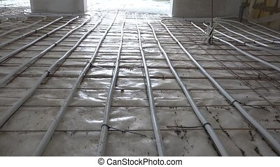 water floor heating system pipes hoses lay in house