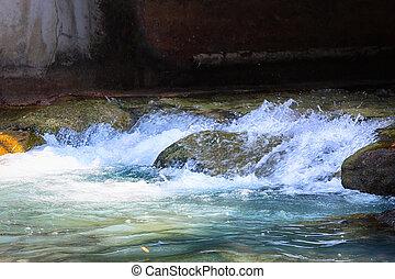 water flow between stones