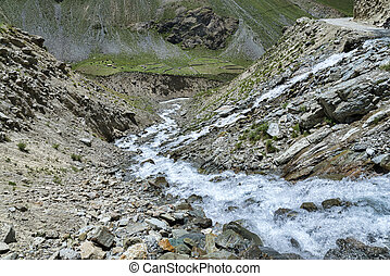 Water flow over mountain road