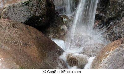 Water flow over stones