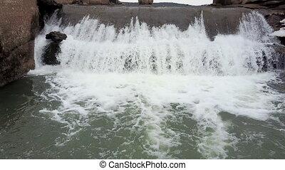 Water flow under bridge. Flight on quadcopter. Top view