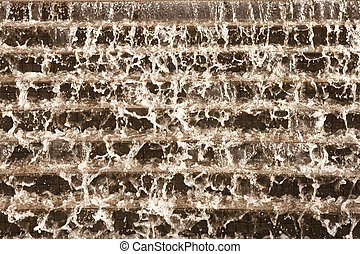 Water Flowing Down a Stone Fountain