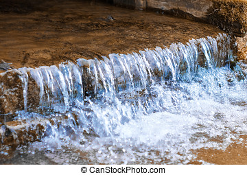 Water flowing from a dam on lake