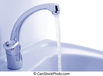 Water flowing from the faucet against the white background