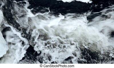 Water flowing in winter