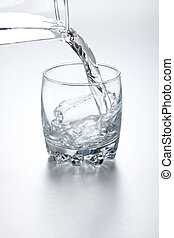 Water flowing into glass