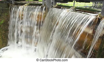 water flowing through sluice and falling, 4th Lock, Circle Line, Grand Canal, Baggott Street in Dublin, Ireland