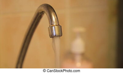 water flows from the kitchen faucet