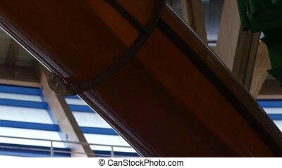 water flows in pipe on water slide in amusement park. 4K -...