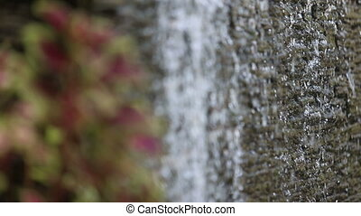 water flows through stone wall