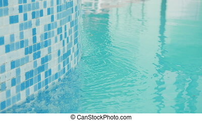 water flows through the blue little tile in the pool