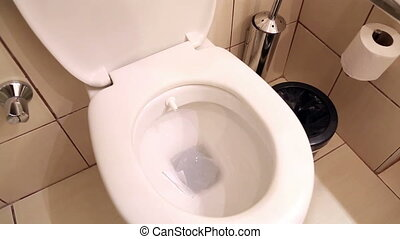Water flushing in toilet bowl