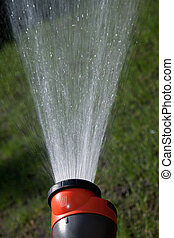 Water flying out of the hose