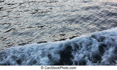 water foam from ripple at sea sunset