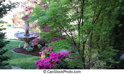 Water Fountain in Colorful Garden - Water Fountain with...