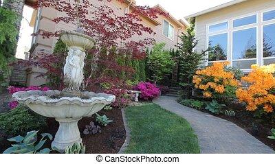 Water Fountain in Garden Springtime - Water Fountain in...