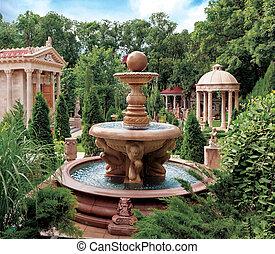 Scenic view of decorative water fountain and structures in old park, Cabardinca, Gelendzhik, Krasnodar Krai, Russia.