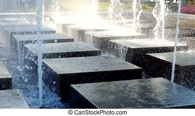 Water fountain on the city square. Modern fountain in a park