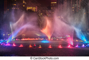 water fountains in kuala lumpur - bright colourful water...