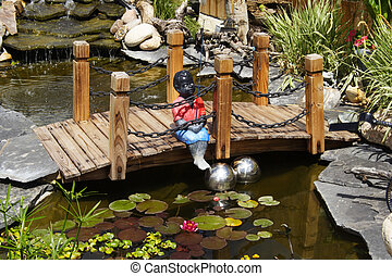 Water Garden - A beautifully designed water garden with boy...