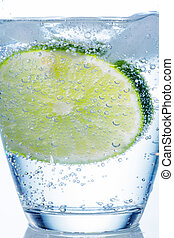 water glass and lime - a glass of fresh drinking water and a...
