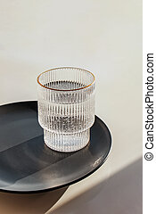 Water glass with strong shadows