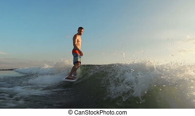 Water Gliding - Surfboard rider approaching camera...