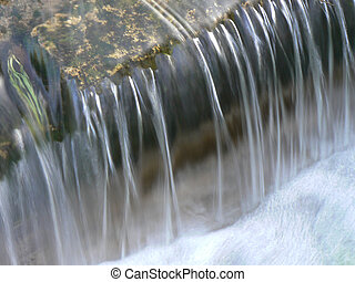 water gush or waterfall - fresh and clean water of a ...